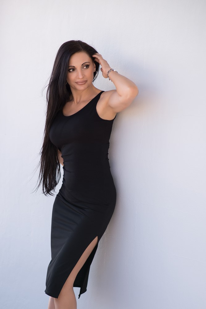 Isabelle channels a touch of European glamour in her Bullet Blues' sleeveless little black dress